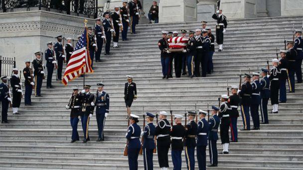 PHOTO: The flag-draped casket of former President George H.W. Bush is carried by a joint services military honor guard from the U.S. Capitol, Dec. 5, 2018, in Washington. (Alex Brandon/Pool via AP)