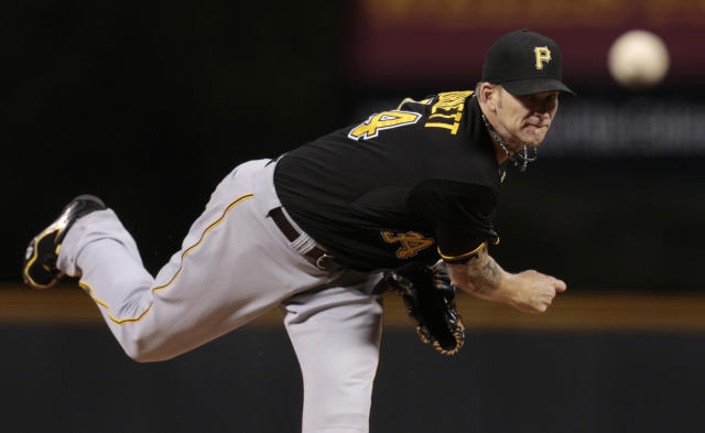 PIttsburgh Pirates starting pitcher A.J. Burnett delivers against the Colorado Rockies in the first inning of a baseball game in Denver, Saturday, Aug. 10, 2013. (AP Photo/Joe Mahoney)