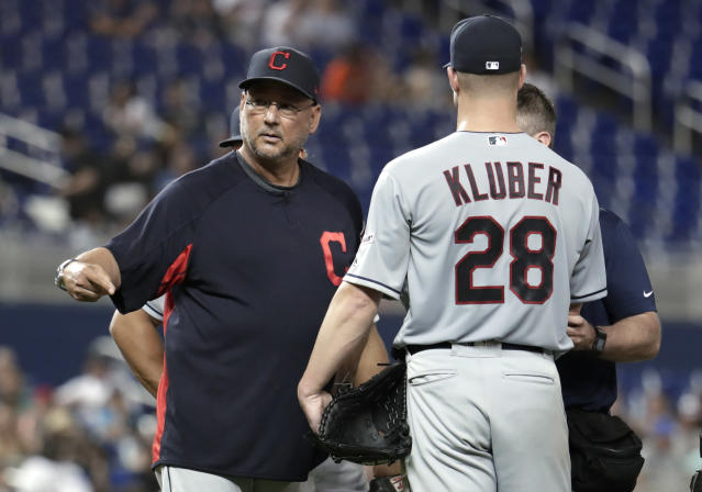 Cleveland Indians manager Terry Francona, left, stands on the mound with starting pitcher Corey Kluber (28) during the fifth inning of the team's baseball game against the Miami Marlins, Wednesday, May 1, 2019, in Miami. Kluber was hit by a single hit by Marlins' Brian Anderson. (AP Photo/Lynne Sladky)