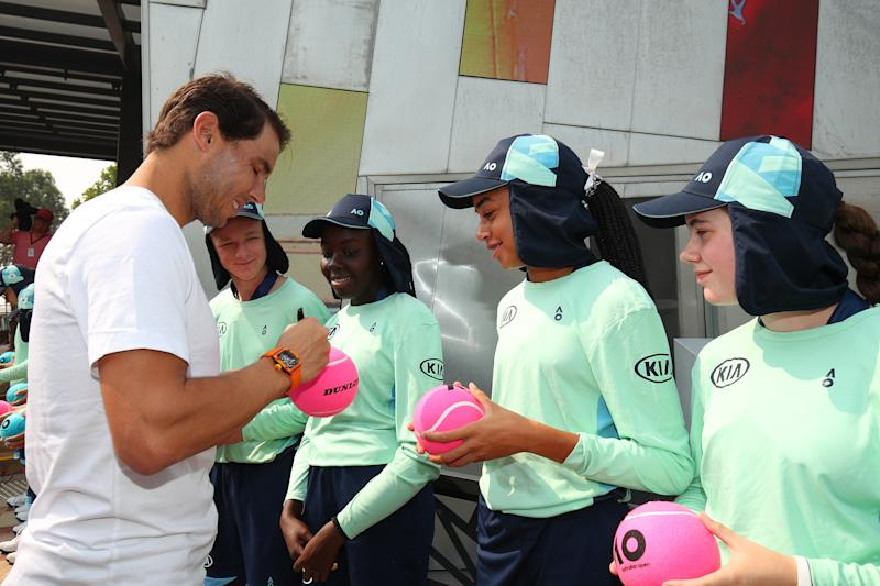 Rafael Nadal signing tennis balls for the Ball Kids ahead of the Australian Open.
