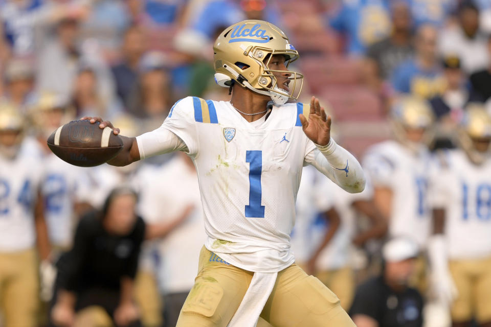 UCLA quarterback Dorian Thompson-Robinson (1) throws a pass against the Stanford during the second half of an NCAA college football game Saturday, Sept. 25, 2021, in Stanford, Calif. (AP Photo/Tony Avelar)