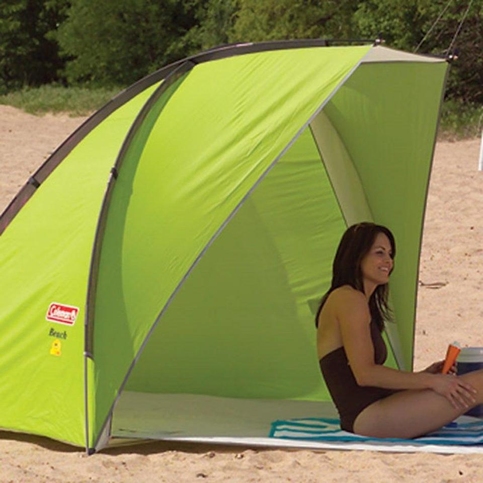 """The camping experts at Coleman thought of everything with this lime-hued sun shelter, which is large enough for two adults at almost eight feet wide. The roll-out floor can zip up for privacy, and there's even a line for hanging clothes to dry. Set up will take about five minutes with this model — a small time commitment for such a convenient, well-thought-out shade. <br> <br> <strong>Coleman</strong> Coleman Beach Shade, $, available at <a href=""""https://go.skimresources.com/?id=30283X879131&url=https%3A%2F%2Fwww.walmart.com%2Fip%2FColeman-Beach-Shade-Green%2F3661081"""" rel=""""nofollow noopener"""" target=""""_blank"""" data-ylk=""""slk:Walmart"""" class=""""link rapid-noclick-resp"""">Walmart</a>"""