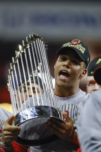 Washington Nationals' Juan Soto celebrates after Game 7 of the baseball World Series against the Houston Astros Wednesday, Oct. 30, 2019, in Houston. The Nationals won 6-2 to win the series. (AP Photo/Matt Slocum)