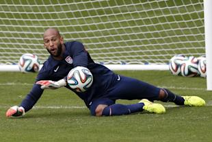 Tim Howard dives at a shot during a training session at the Sao Paulo FC training center on Wednesday. (AP)