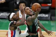 Boston Celtics' Jeff Teague (55) shoots against Detroit Pistons' Jerami Grant, left, during the second half of an NBA basketball game, Friday, Feb. 12, 2021, in Boston. (AP Photo/Michael Dwyer)