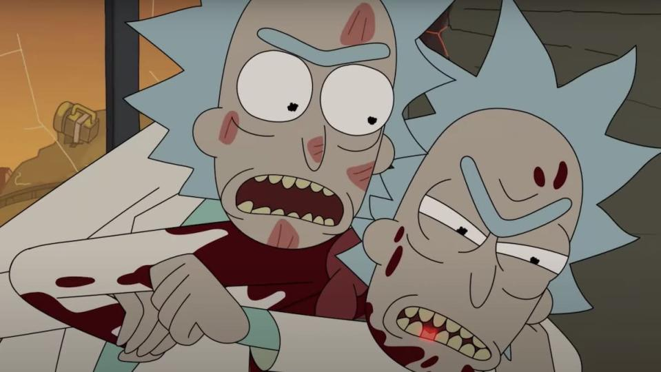 A bloodied Rick puts another Rick in a headlock