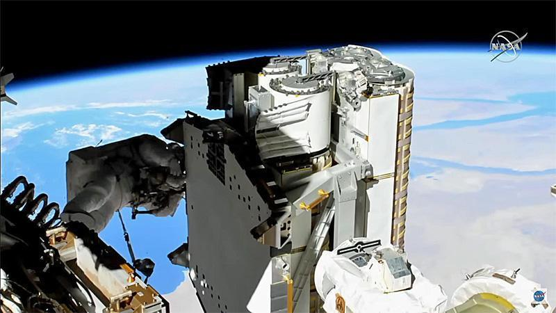 New high-definition helmet cameras give flight controllers -- and the public -- spectacular views from the perspective of the spacewalkers. This show shows the Red Sea and the Nile River to the right of the iROSA solar arrays. / Credit: NASA TV