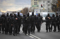 Belarusian police block a street during an opposition rally to protest the official presidential election results in Minsk, Belarus, Sunday, Nov. 1, 2020. Nearly three months after Belarus' authoritarian president's re-election to a sixth term in a vote widely seen as rigged, the continuing rallies have cast an unprecedented challenge to his 26-year rule. (AP Photo)