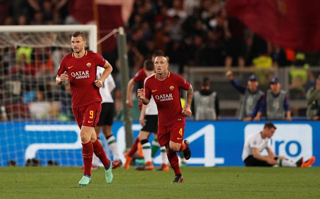 <p>Soccer Football – Champions League Semi Final Second Leg – AS Roma v Liverpool – Stadio Olimpico, Rome, Italy – May 2, 2018 Roma's Edin Dzeko celebrates scoring their second goal with Radja Nainggolan Action Images via Reuters/John Sibley </p>