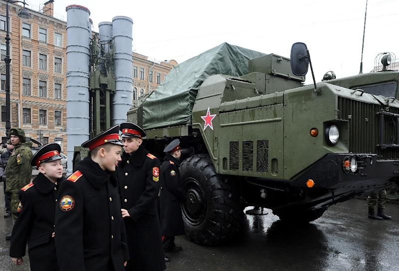Cadets walk close to a Russian surface-to-air missile system S-300 PMU during a military exhibition in Saint Petersburg on February 20, 2015