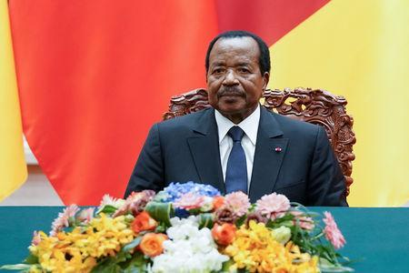 FILE PHOTO: President of Cameroon Paul Biya with Chinese President Xi Jinping (not pictured) attend a signing ceremony at The Great Hall Of The People in Beijing, China March 22, 2018. Lintao Zhang/Pool via Reuters/File Photo