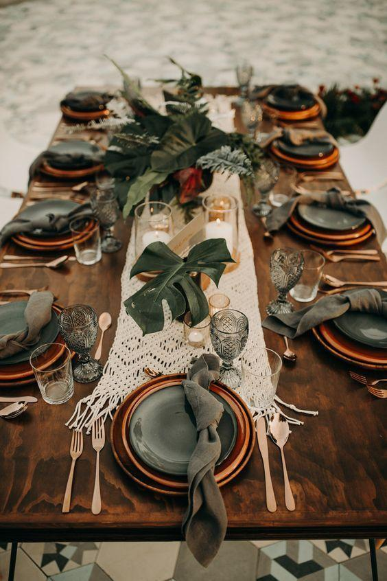 """<p>Juxtaposing a deeper burnt orange with forest green creates a moody yet natural tablescape. Add some soft lighting or a few candles and your table is complete.</p><p><a class=""""link rapid-noclick-resp"""" href=""""https://junebugweddings.com/wedding-blog/this-moody-tropical-wedding-at-acre-baja-plays-up-the-gorgeous-natural-surroundings/"""" rel=""""nofollow noopener"""" target=""""_blank"""" data-ylk=""""slk:See more at Junebug Weddings"""">See more at Junebug Weddings</a></p>"""