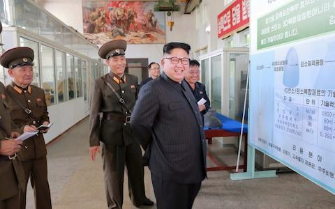 <span>North Korean leader Kim Jong-Un smiles during a visit to the Chemical Material Institute of the Academy of Defense Science in this undated photo released by North Korea's Korean Central News Agency (KCNA) in Pyongyang on August23, 2017</span> <span>Credit: Reuters </span>