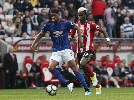 Britain Football Soccer - Sunderland v Manchester United - Premier League - Stadium of Light - 9/4/17 Manchester United's Marcus Rashford in action with Sunderland's Didier Ndong Reuters / Russell Cheyne Livepic