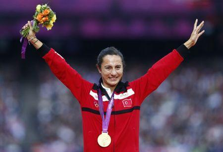FILE PHOTO: Gold medallist Turkey's Asli Cakir Alptekin smiles during the women's 1500m victory ceremony at the London 2012 Olympic Games at the Olympic Stadium August 11, 2012. REUTERS/Eddie Keogh/File Photo