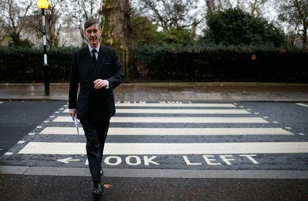 British Conservative Party Member of Parliament Jacob Rees-Mogg crosses the street outside the Houses of Parliament, after Prime Minister Theresa May's Brexit deal was rejected, in London, Britain, January 16, 2019. REUTERS/Henry Nicholls