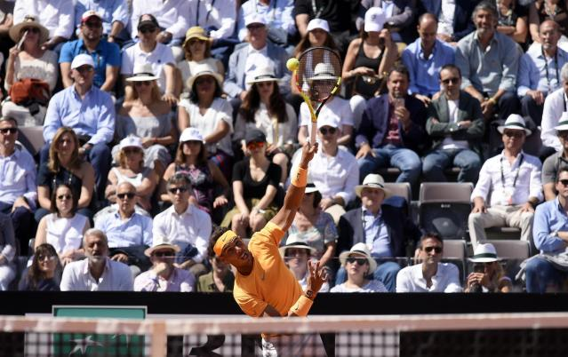 Spain's Rafael Nadal serves the ball to Serbia's Novak Djokovic during their semifinal match at the Italian Open tennis tournament, in Rome, Saturday, May 19, 2018. (Claudio Onrati/ANSA via AP)