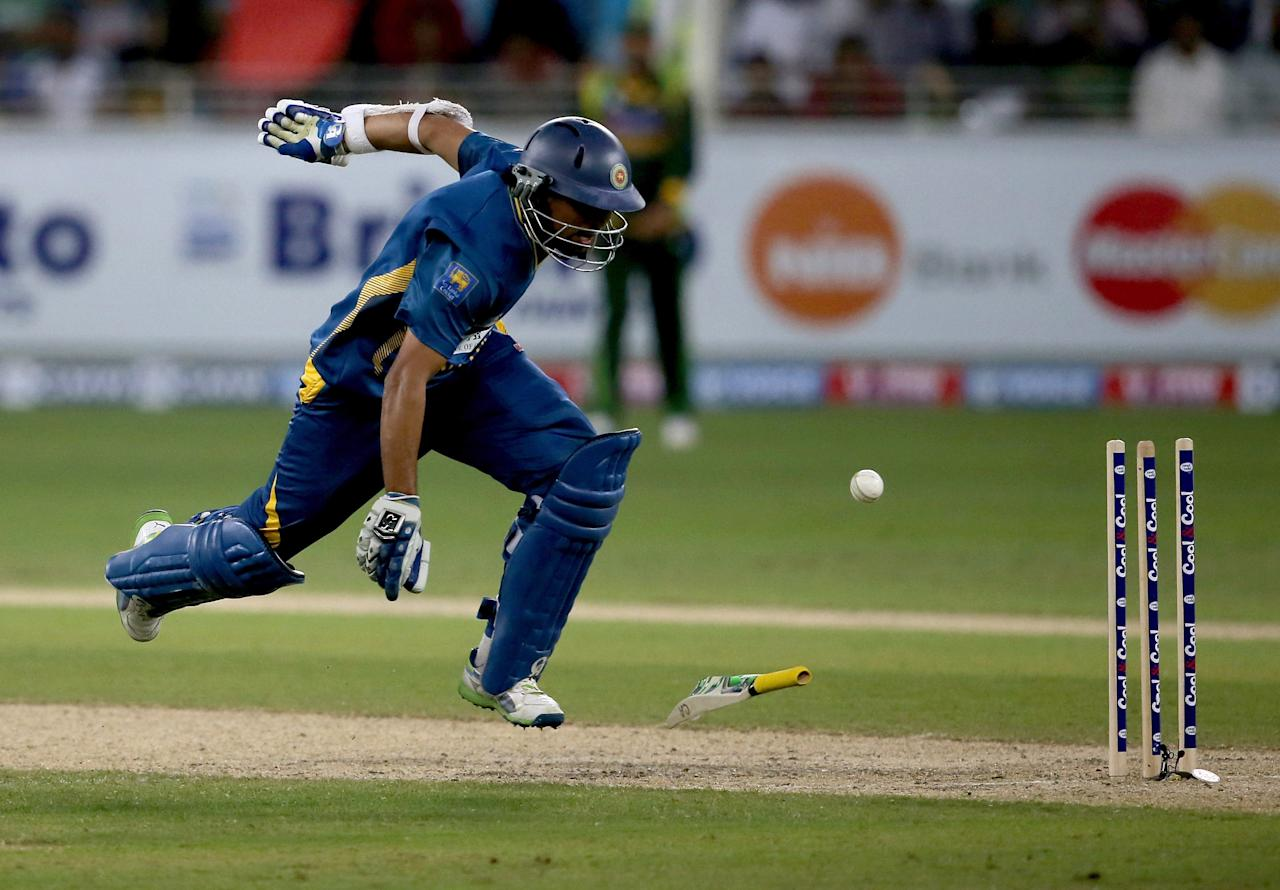 DUBAI, UNITED ARAB EMIRATES - DECEMBER 20:  TM Dilshan of Sri Lanka is run out during the second One-Day International (ODI ) match between Sri Lanka and Pakistan at the Dubai Sports City Cricket Stadium on December 20, 2013 in Dubai, United Arab Emirates.  (Photo by Francois Nel/Getty Images)
