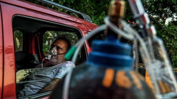 PHOTO: A man receives oxygen in a vehicle at a Sikh gurdwara (temple) in Delhi, April 25, 2021. (Atul Loke/The New York Times/Redux Pictures)