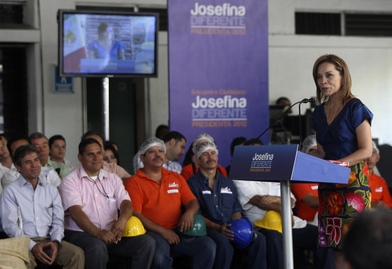 Josefina Vazquez Mota, right, presidential candidate for the National Action Party (PAN), center, delivers a speech during a campaign stop in Guadalajara, Mexico, Sunday April 15, 2012. On a campaign swing through the heart of her political stronghold, Vazquez Mota, the first serious female contender for Mexico's presidency, didn't fill a town square or even the tables of a business luncheon. (AP Photo/Bruno Gonzalez)