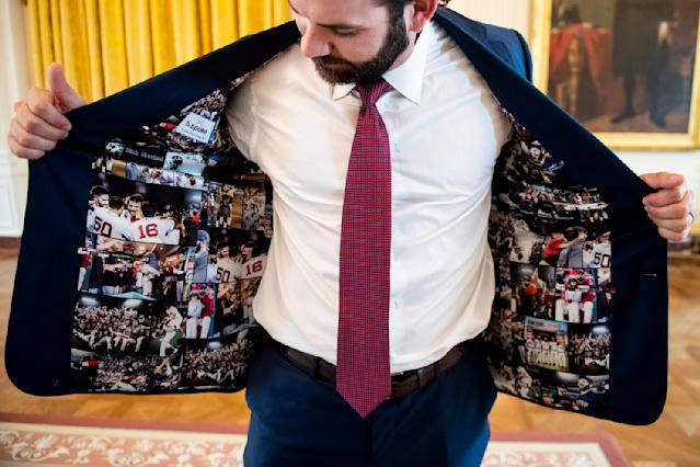 WASHINGTON, DC - MAY 9: Mitch Moreland #18 of the Boston Red Sox displays his jacket as he takes a tour during a visit to the White House in recognition of the 2018 World Series championship on May 9, 2019 in Washington, DC. (Photo by Billie Weiss/Boston Red Sox/Getty Images)