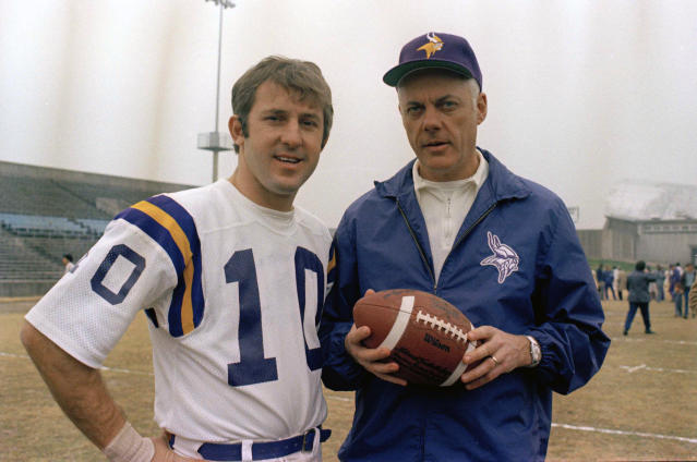 FILE - In this Jan. 7, 1974, file photo, Minnesota Vikings quarterback Fran Tarkenton (10) poses with coach Bud Grant in an unknown location. Grant was the first coach to reach four Super Bowls. Also the first to lose four Super Bowls. Grant built a powerhouse team over 18 seasons with the Vikings, reaching the playoffs 12 times. But his squads always flopped badly on the biggest stage, losing each of their four title games by double-digit margins. (AP Photo/Ferd Kaufman, File)