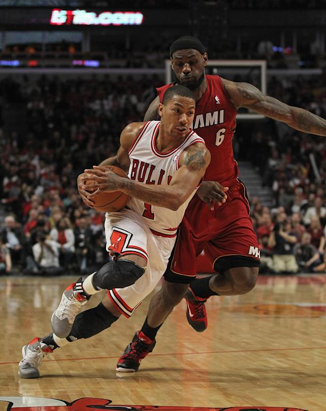 CHICAGO, IL - APRIL 12: Derrick Rose #1 of the Chicago Bulls drives past LeBron James #6 of the Miami Heat at the United Center on April 12, 2012 in Chicago, Illinois. The Bulls defeated the Heat 96-86 in overtime. NOTE TO USER: User expressly acknowledges and agrees that, by downloading and or using this photograph, User is consenting to the terms and conditions of the Getty Images License Agreement. (Photo by Jonathan Daniel/Getty Images)