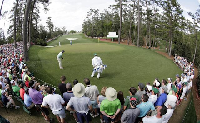 Matt Kuchar putts on the 10th green during the fourth round of the Masters golf tournament Sunday, April 13, 2014, in Augusta, Ga. (AP Photo/Charlie Riedel)