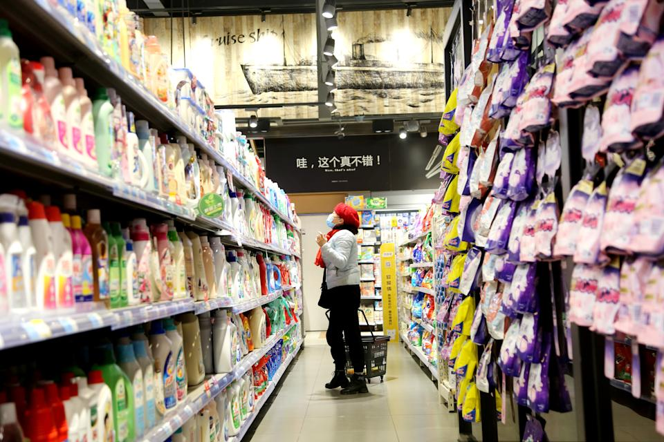 LIANYUNGANG, March 10, 2021 -- People select products at a supermarket in Lianyungang City, east China's Jiangsu Province, March 10, 2021. China's consumer price index CPI, a main gauge of inflation, declined 0.2 percent year on year in February due to a higher comparison base last year, data from the National Bureau of Statistics NBS showed Wednesday.    Food prices went down 0.2 percent year on year, dragging down the consumer inflation by 0.05 percentage points, according to the data. (Photo by Wang Chun/Xinhua via Getty) (Xinhua/Wang Chun via Getty Images)