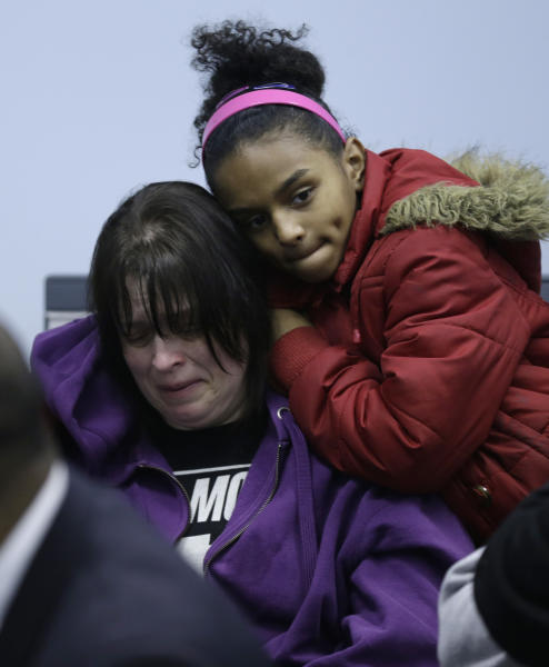 Deanna Behner, left, mother of victim Kirklan Behner, is comforted by her daughter, Samantha, during a prayer service Monday, March 11, 2013, in Warren, Ohio. Community members crowded into a prayer service to remember six teens killed when an SUV flipped over a guardrail and landed upside down in a pond. (AP Photo/Tony Dejak)