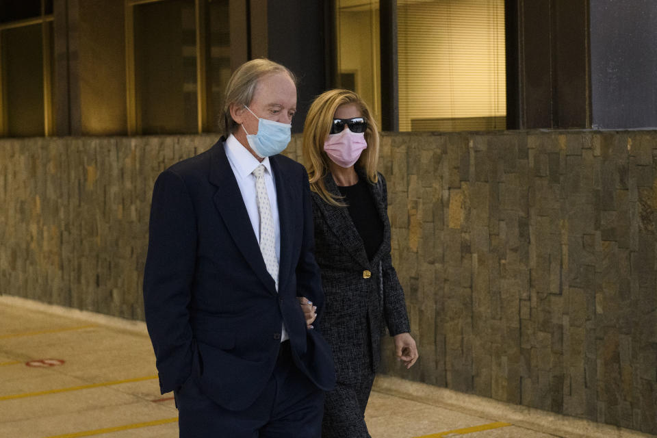 Bill Gross, founder of investment company PIMCO (L) and partner Amy Schwartz depart after a court hearing in Santa Ana, California, December 7, 2020. - Mark Towfiq and wife Carol Nakahara are suing neighbors Bill Gross and Amy Schwartz over complaints that they played loud music, including the theme to Gilligan's Island, in response to a dispute over an art installation on Gross' property, while Gross filed a cross-complaint against his neighbor. (Photo by Patrick T. Fallon / AFP) (Photo by PATRICK T. FALLON/AFP via Getty Images)
