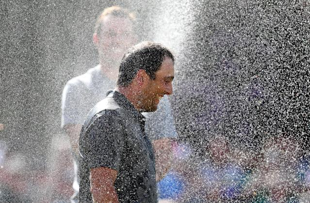 Golf - European Tour - BMW PGA Championship - Wentworth Club, Virginia Water, Britain - May 27, 2018 Italy's Francesco Molinari is sprayed with champagne after winning the BMW PGA Championship Action Images via Reuters/Peter Cziborra