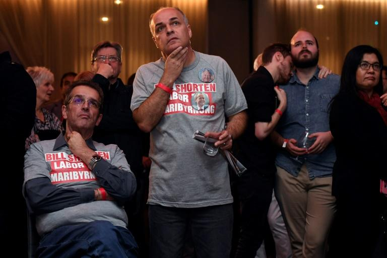 Anxious supporters of opposition Labor leader Bill Shorten watch the giant screens showing the results of Australia's general election in Melboune