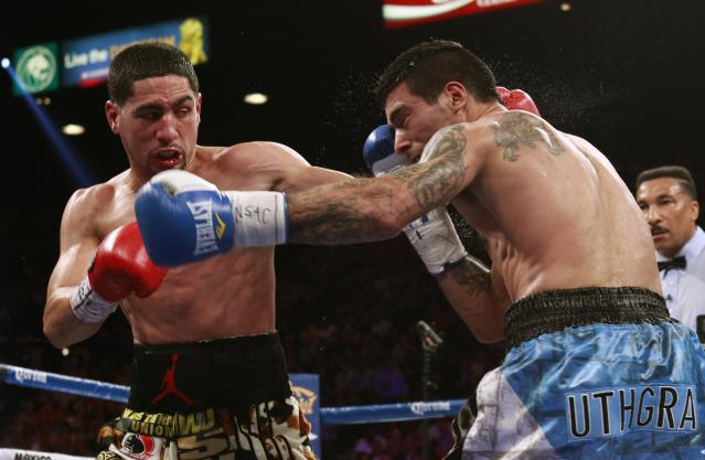 WBC/WBA junior welterweight champion Danny Garcia (L) of the U.S. connects on Lucas Matthysse of Argentina during their title fight at the MGM Grand Garden Arena in Las Vegas, Nevada, September 14, 2013. REUTERS/Steve Marcus (UNITED STATES - Tags: SPORT BOXING TPX IMAGES OF THE DAY)