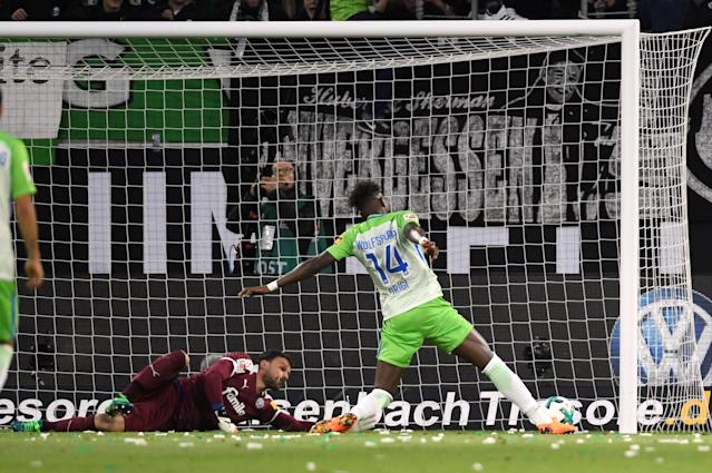 Soccer Football - Bundesliga Promotion/Relegation Playoff First leg - VfL Wolfsburg v Holstein Kiel - Volkswagen Arena, Wolfsburg, Germany - May 17, 2018 Wolfsburg's Divock Origi scores their first goal REUTERS/Fabian Bimmer DFL RULES TO LIMIT THE ONLINE USAGE DURING MATCH TIME TO 15 PICTURES PER GAME. IMAGE SEQUENCES TO SIMULATE VIDEO IS NOT ALLOWED AT ANY TIME. FOR FURTHER QUERIES PLEASE CONTACT DFL DIRECTLY AT + 49 69 650050