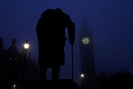 FILE PHOTO:  The Houses of Parliament and a statue of Winston Churchill are seen on a foggy morning in London, Britain, December 30, 2016.      REUTERS/Stefan Wermuth