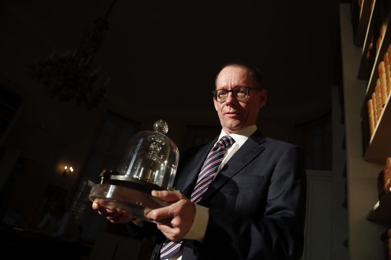 The Latest: Landmark change to kilogram approved