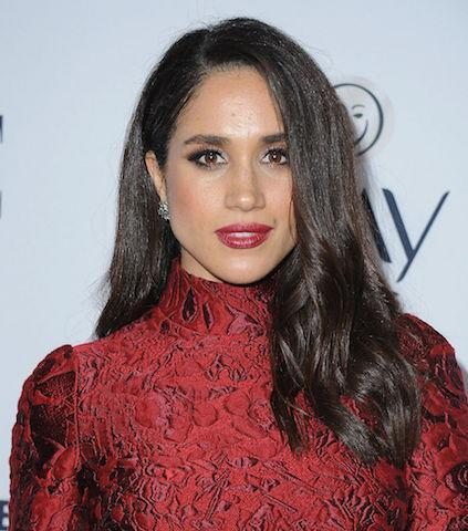 <p>Just a year before meeting Prince Harry, Meghan attended Elle magazine's sixth annual Women in Television event. For the occasion, she wore her hair with a deep side part. (Photo: Getty Images) </p>
