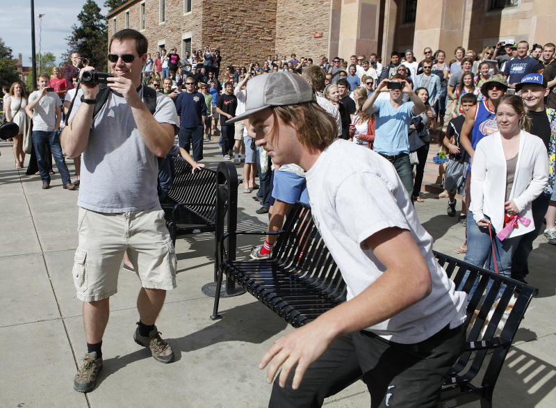 A student runs toward the police barrier on the Norlin Quad at the University of Colorado in Boulder, Colo., on Friday, April 20, 2012, at 4:20pm. He was run down by police and arrested after crossing the barrier.  Police blocked off the quad to prevent a 420 marijuana smoke out. (AP Photo/Ed Andrieski)