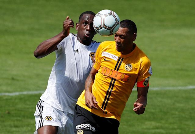 Soccer Football - Uhrencup - BSC Young Boys v Wolverhampton Wanderers - Stadion Neufeld, Bern, Switzerland - July 14, 2018 Young Boys' Guillaume Hoarau in action with Wolverhampton Wanderers' Willy Boly REUTERS/Stefan Wermuth