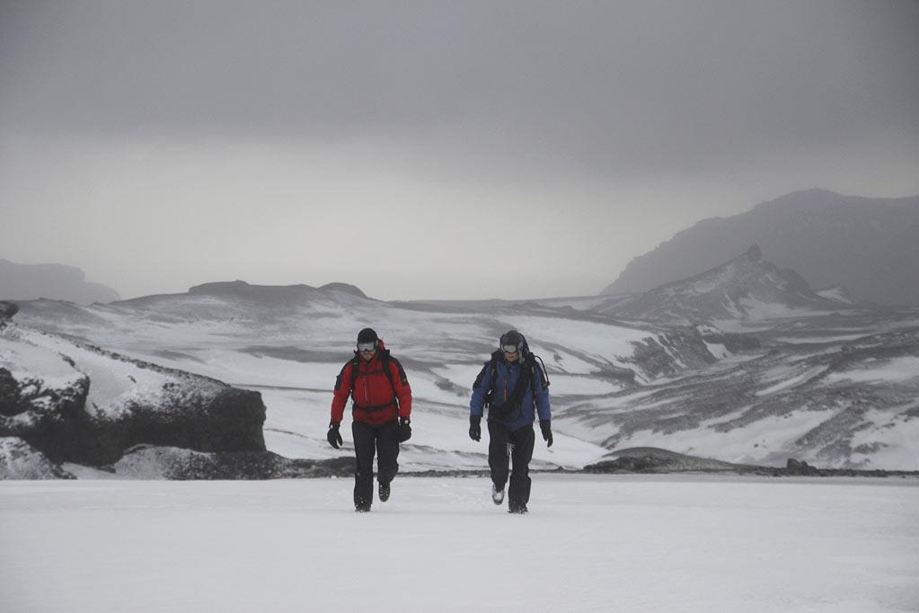 "Bear Gylls and Jake Gyllenhaal walking on glaciers in Iceland as seen on ""Man vs. Wild."""