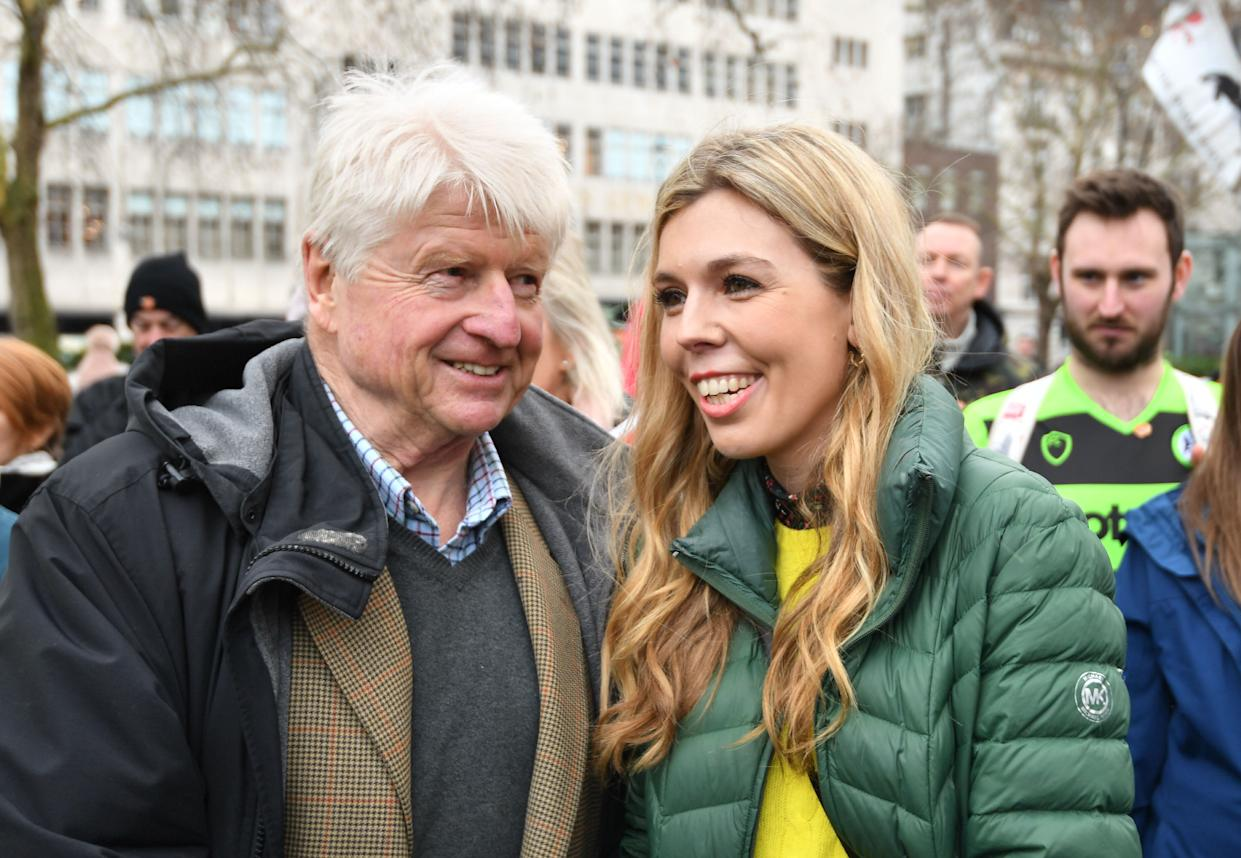 Stanley Johnson introduces himself to Carrie Symonds at an anti-whaling protest outside the Japanese Embassy in central London. (Photo by John Stillwell/PA Images via Getty Images)