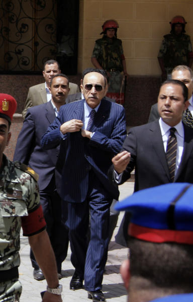 FILE - In this Saturday, April 7, 2012 file photo, former Egyptian Vice President and spy chief Omar Suleiman is escorted by police and aides after he submitted his candidacy papers at the Higher Presidential Elections Commission, in Cairo. Egypt's state news agency says former spy chief and vice president Suleiman died in US. Egypt's Middle East News Agency said on Thursday, July 19, 2012 in a brief statement that Suleiman died in a US hospital early this morning. It didn't give further details. (AP Photo, File)