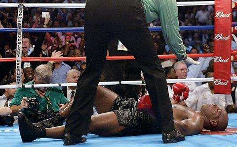 <span>Mike Tyson is knocked out by Lennox Lewis</span> <span>Credit: EPA </span>