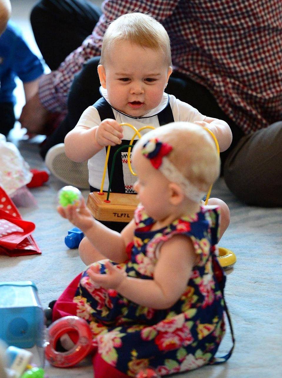 """<p>How can you not squeal looking at those cheeks?! It's not humanly possible. <a href=""""https://www.goodhousekeeping.com/life/a22506679/kate-middleton-prince-george-birthday-portrait/"""" rel=""""nofollow noopener"""" target=""""_blank"""" data-ylk=""""slk:Prince George"""" class=""""link rapid-noclick-resp"""">Prince George</a> playing with his toy during his parents' tour of New Zealand and Australia is just all around too much. </p>"""