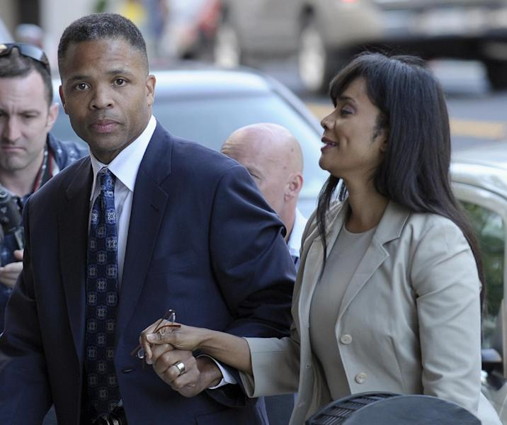 Former Illinois Rep. Jesse Jackson Jr. and his wife, Sandra, arrive at federal court in Washington, Wednesday, Aug. 14, 2013, to learn their fates when a federal judge sentences the one-time power couple for misusing $750,000 in campaign money on everything from a gold-plated Rolex watch and mink capes to vacations and mounted elk heads. (AP Photo/Susan Walsh)