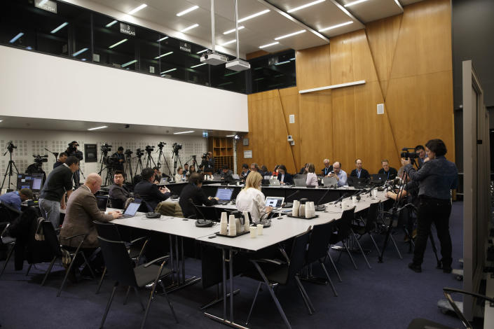 Reporters wait for the World Health Organization's Emergency Committee meeting on what scientists have identified as a new coronavirus, at the World Health Organization (WHO) headquarters in Geneva, Switzerland, Wednesday, Jan. 22, 2020. Health authorities are closely watching an outbreak of respiratory illness caused by a new virus from China. Governments are stepping up surveillance of airline passengers from central China and taking other steps to try to control the outbreak. (Salvatore Di Nolfi/Keystone via AP)