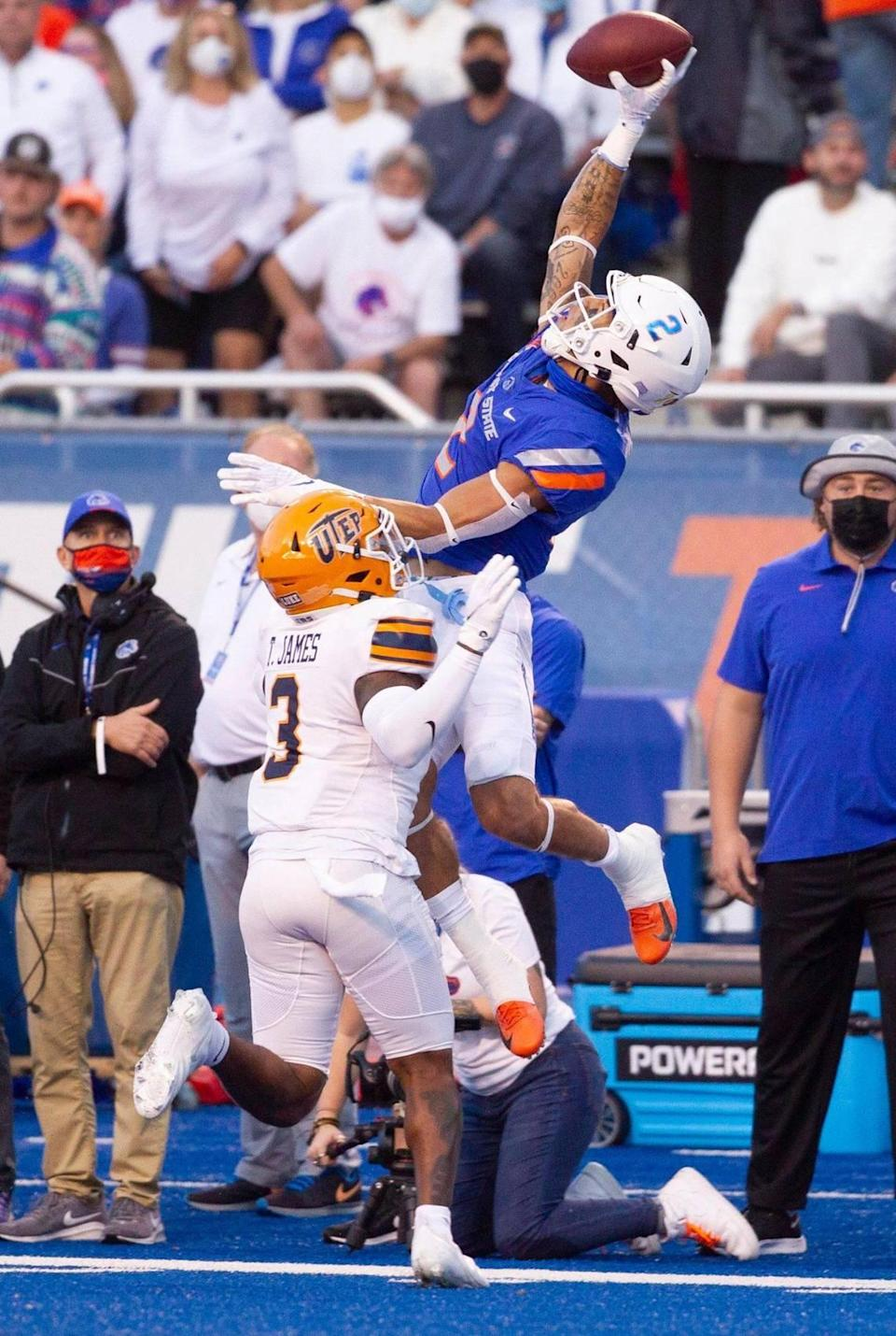 Boise State wide receiver Khalil Shakir reaches high for a one-handed catch while defended by UTEP safety Ty'reke James during the first half of their game at Albertsons Stadium.