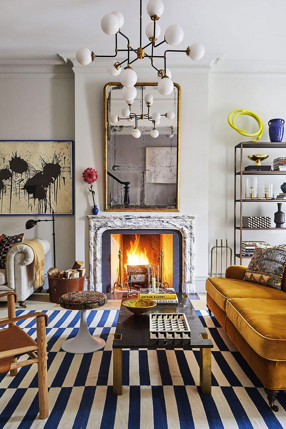"""<p>""""For living rooms, we are seeing plush, comfortable seating, rich tones, and layered styling,"""" says <strong>Mara Miller,</strong> who with her husband, Jesse Carrier, are principals at the <a href=""""https://www.elledecor.com/design-decorate/interior-designers/g3076/a-list-interior-designers/"""" rel=""""nofollow noopener"""" target=""""_blank"""" data-ylk=""""slk:A-List"""" class=""""link rapid-noclick-resp"""">A-List</a> firm <a href=""""https://www.carrierandcompany.com/"""" rel=""""nofollow noopener"""" target=""""_blank"""" data-ylk=""""slk:Carrier and Company"""" class=""""link rapid-noclick-resp"""">Carrier and Company</a>. """"Thanks to <a href=""""https://www.elledecor.com/life-culture/fun-at-home/a32019822/elle-decor-zoom-backgrounds/"""" rel=""""nofollow noopener"""" target=""""_blank"""" data-ylk=""""slk:Zoom backgrounds"""" class=""""link rapid-noclick-resp"""">Zoom backgrounds</a>, accessorizing and styling are finally getting the credit they deserve. We see accessorizing becoming bolder, more artful, and more personal in 2021."""" </p>"""