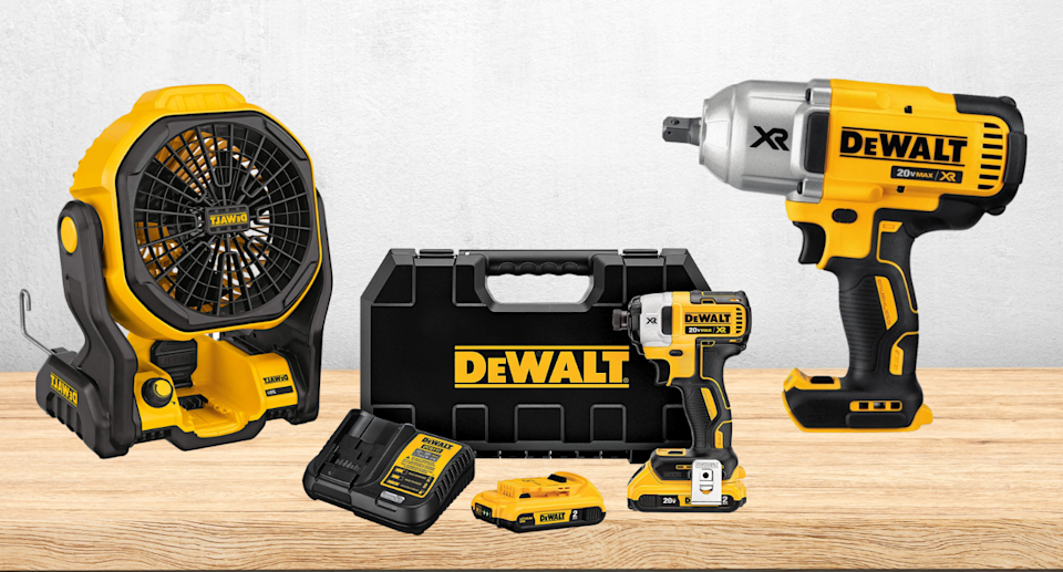DEWALT power tools and accessories on wood bench